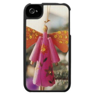 Angel Decoration Hanging from a Christmas Tree iPhone 4 Covers