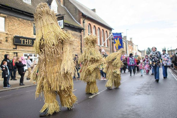 """The three Straw Bears are led through the streets during the annual Whittlesea Straw Bear Festival parade on Jan. 14, 2017 in Whittlesey, United Kingdom. The traditional event was revived in 1980 and features a """"Straw Bear"""" and it's children being led through the streets of the English village of Whittlesey, near Peterborough, United Kingdom.  More..."""