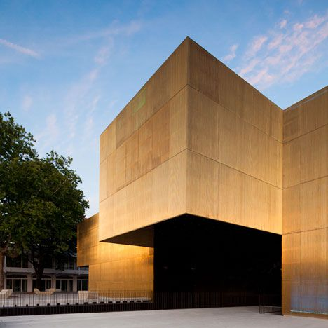 Shimmering brass walls surround this arts centre