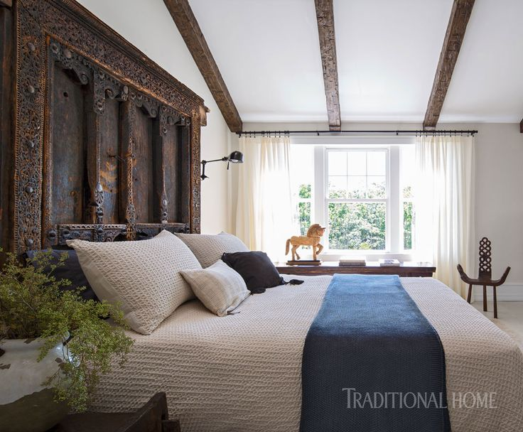 A Set Of Antique Doors From Pakistan Serves As A Headboard In This Rustic,  Worldly