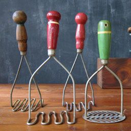 vintage kitchen tools - we had the big red potato masher in the center and I believe the green one, too.  :)