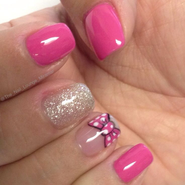 Minnie Mouse bow nail art design