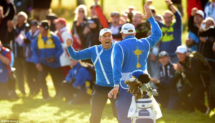 Sergio Garcia goes to celebrate with his caddy after a holing a shot from the bunker on th...