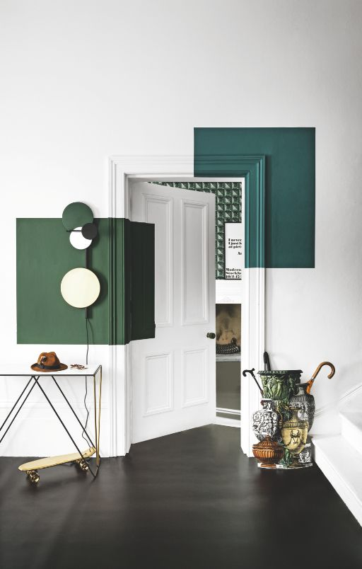 If you don't want to commit to painting your entire door one colour then why not experiment with several colours using geometric shapes. Image: Livingetc