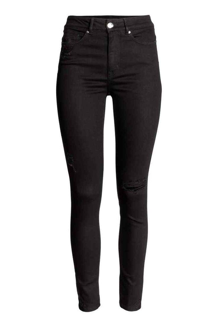 Dżinsy Skinny High: Dżinsy z 5 kieszeniami z bardzo elastycznego denimu z detalami mocnego zużycia. Wysoka talia i bardzo wąskie nogawki do kostki.