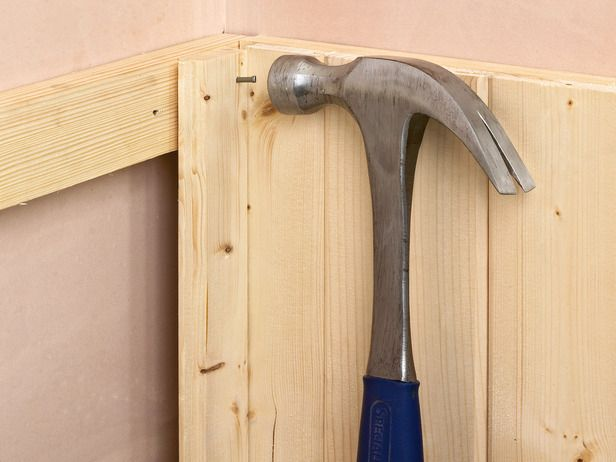 DIYNetwork.com has photos and instructions on how to install interlocking tongue-and-groove wall panels for wainscoting.