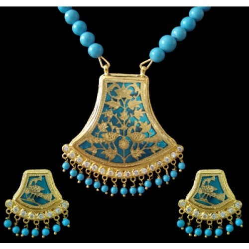 Thewa Jewelry. a 400 years old national award winning art practised by handful of Rajasthani artisans. Thewa is fusion of 23 K gold with glass.   www.craftsvilla.com