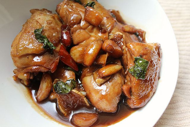 Taiwan Three Cup Chicken (braising liquid made with 1 cup each soy sauce, rice wine and sesame oil with chicken, fried garlic and ginger, and finished with fresh basil.