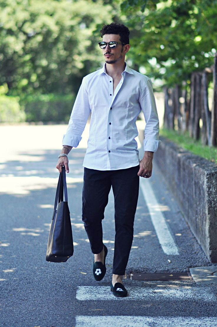 This combination of a white button-down shirt and black chinos is perfect for off-duty occasions. For footwear go down the classic route with black embroidered suede loafers.  Shop this look for $421:  http://lookastic.com/men/looks/white-longsleeve-shirt-and-black-chinos-and-black-tote-bag-and-black-loafers/3110  — White Long Sleeve Shirt  — Black Chinos  — Black Leather Tote Bag  — Black Embroidered Suede Loafers