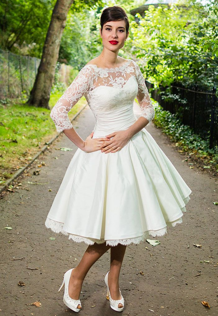 Sweetheart neckline chic wedding dress with a 3/4 sleeved high neck lace bolero.