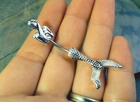 Mermaid in-n-out belly button jewelry ring. Made of 316L surgical steel, the barbell is 14 gauge and 7/16 long. This is a really unique belly ring!