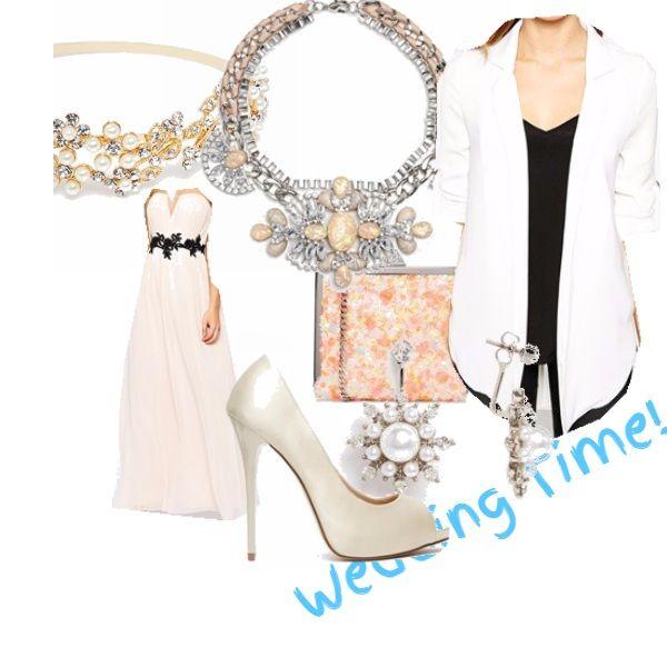 Tempo di matrimoni!  E se si sceglie un rito civile o una cerimonia all'aria aperta.... liberiamo la fantasia!  un vestito lungo, di un tenue color rosa pastello, morbida, reso di tendenza da un elemnto collorato, è completato dalla giacca  e dagli accessori... perle, sia per il cerchietto che la maxy-collana (ideale per un vestito così semplice) che per gli orecchini.