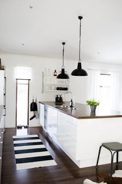 Dark floors, white cupboards, dark cabinets and love the pendants.