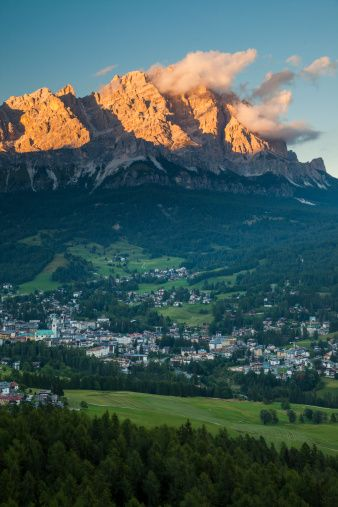 Sunset over the town of Cortina d'Ampezzo. Cortina d'Ampezzo is a town and comune in the Dolomites in northern Italy. It is a popular winter sport resort town.