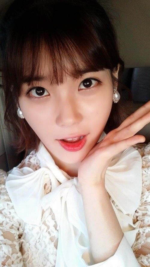 IU Greets Fancafe Members with Princess-Like Selca | Soompi