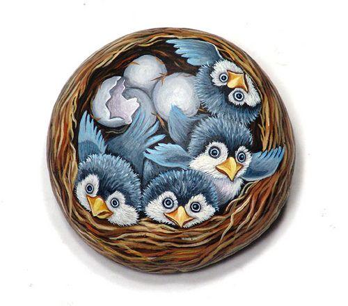 nido - nest acrylic painting on river rock