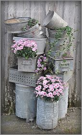 Old galvanized metal containers with floral splashes... Love thisidea for veranda/patio dressing