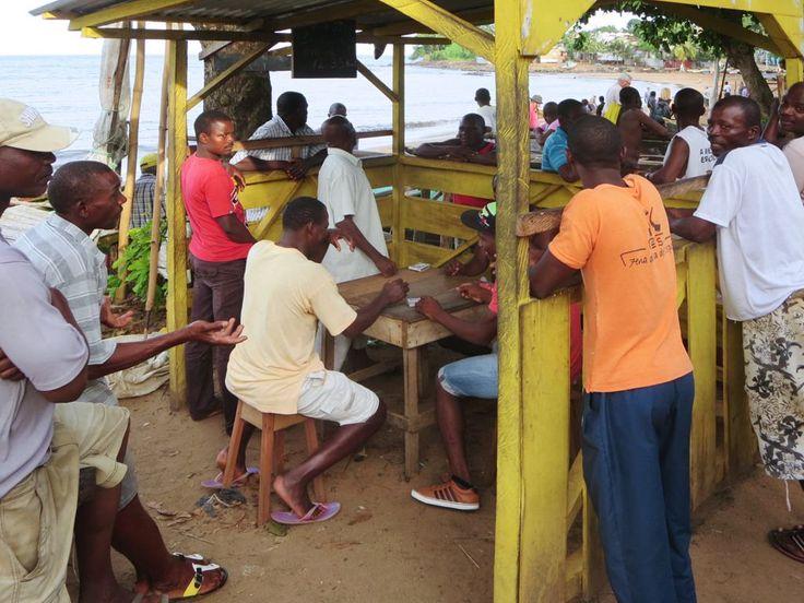 Fishermen enjoying some relaxation at Praia Melão on Sao Tome Island, São Tomé and Príncipe.