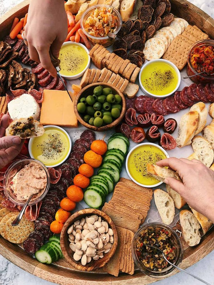 For your next party, learn how to make an Epic Charcuterie Board, with baguette bread and dipping spices, cured meats, cheeses, veggies, nuts, olives, bruschetta, figs and crostini crackers!