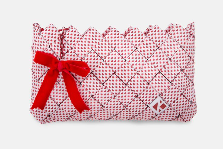 Liebe. Handmade mini clutch bag based on a pattern illustrating red hearts. Accompanied by a red zipper and a red handmade velvet bow for pendant.  The pattern  is digitally printed and enriched with a professional photographic plastic; providing UV protection in order to maintain and protect the colors adding 100% waterproofness.