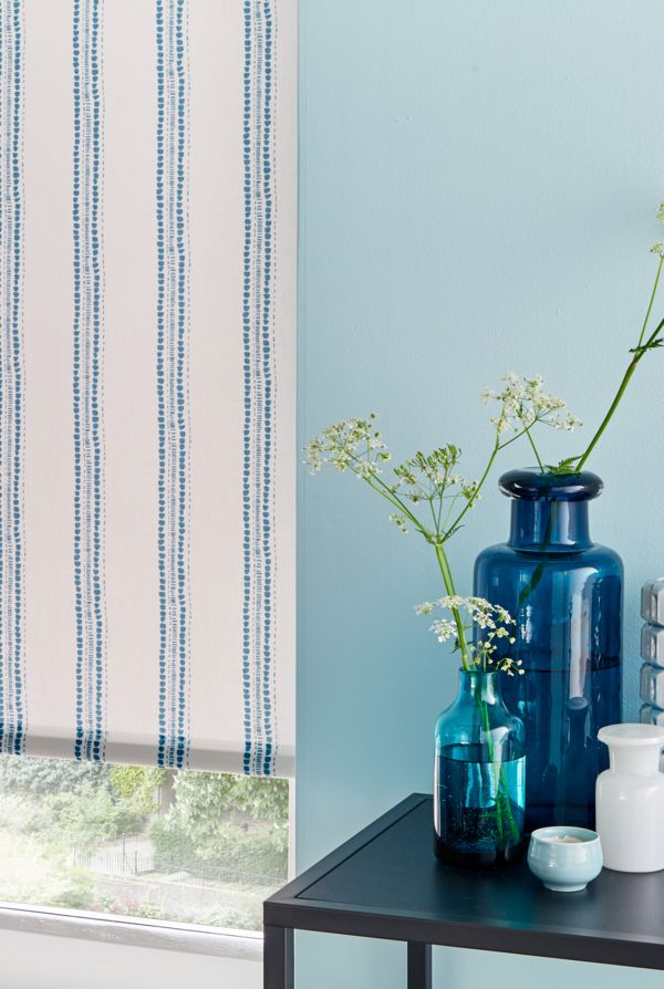 Add a nautical touch to your interiors with the help of a vertical stripe. Our Candra Dark Teal Roller blind is the perfection addition to a blue themed room.