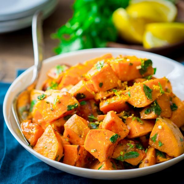 Roasted sweet potatoes with citrus dressing, with cilantro and chives.
