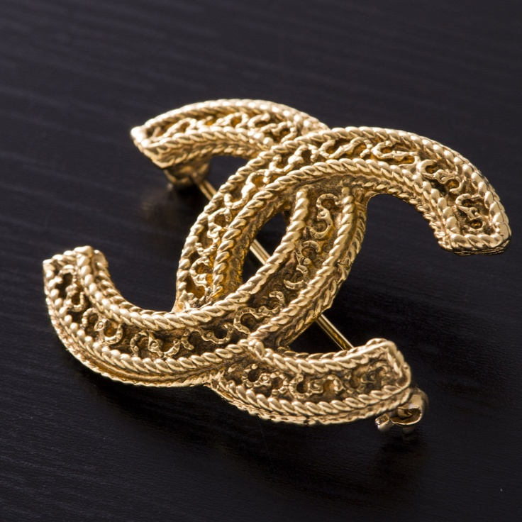 Make any jacket better with this brooch. Vintage, made in France