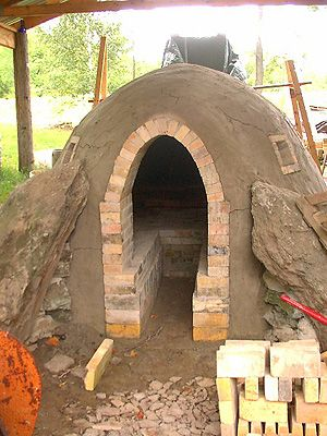 build a wood-fired pottery kiln. http://www.stonymeadowpottery.com/images/kiln/10.kilnexterior.jpg