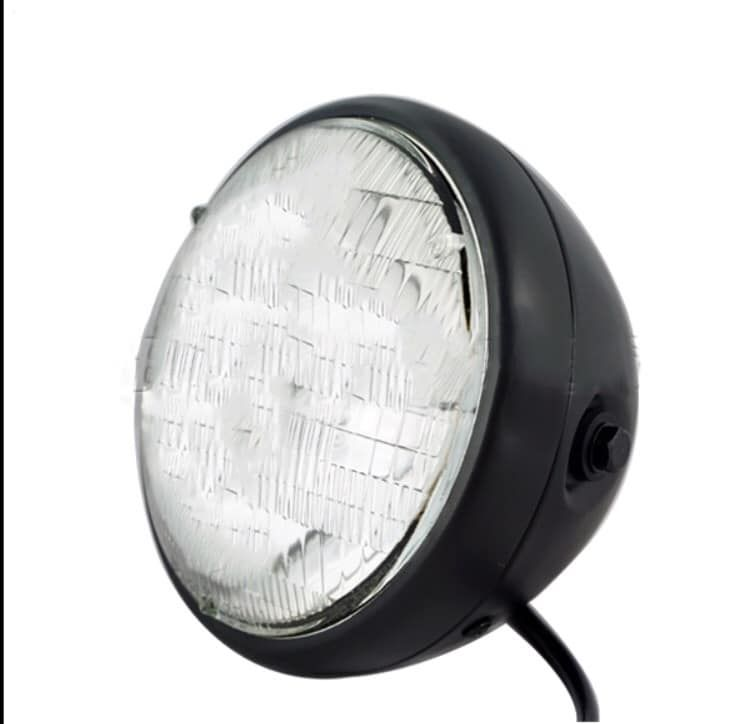Black motorcycle headlight. Perfect for cafe racer, brat, bobber builds. Vintage style headlight. Cafe racer parts and wear.