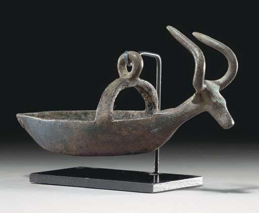 A SARDINIAN BRONZE BOAT NURAGIC PERIOD, CIRCA 8TH CENTURY B.C.