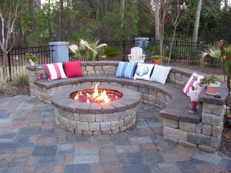 Fireplace, Pretty Decorative Pillows On Curved Stoned Outdoor Seat Plus Outdoor Fire Pit Idea ~ Make Your Exterior More Inviting and Warm Using Enticing Outdoor Fire Pits