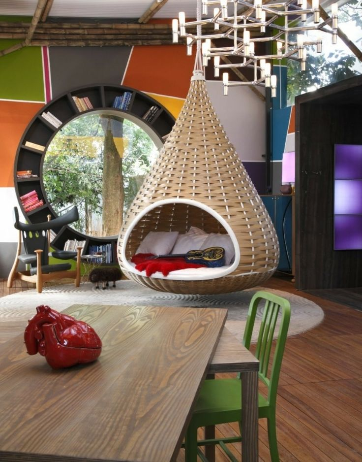 Fábio Galeazzo's Urban Cabin   The circular window book nook is cool and so is the hanging lounge and funky chair.