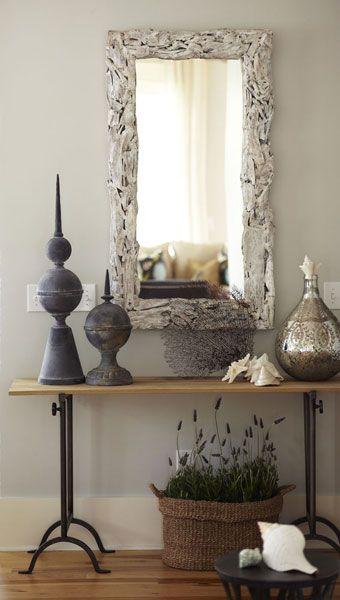 entry - gray and white - industrial console with soft driftwood mirror, baskets with polished metal.