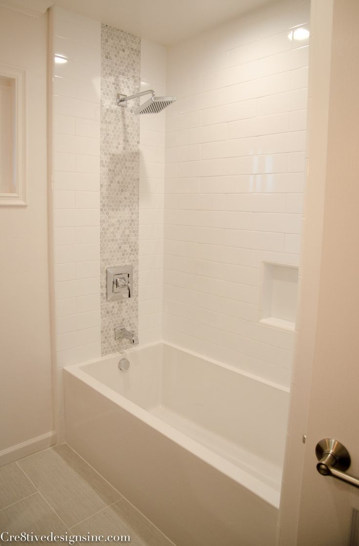 kohler soaking tub and tile accent design