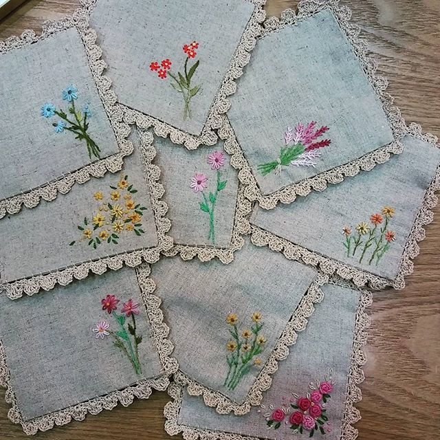 coasters with small embroidery flowers and simple crochet eding