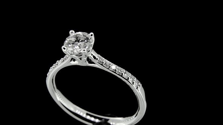 TATIANA ... Elegant Solitiare set with Brilliant Cut Diamond with Pretty Loop Gallery Detail with Accent Diamond set Shoulders in 18ct White Gold. Diamond Wt.- 0.65ct. GIA Cert E/VS1