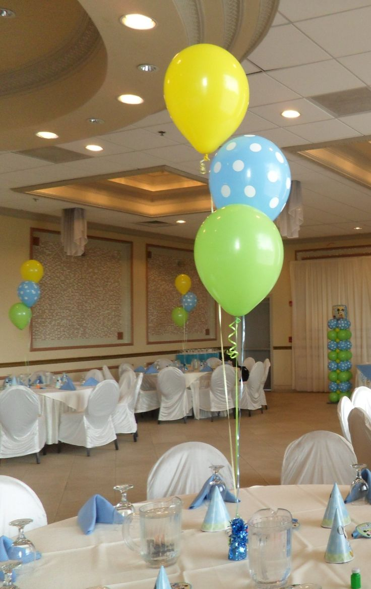 Baby Mickey Mouse balloon centerpiece using lime green, blue polka dot and yellow balloons for a first birthday party.