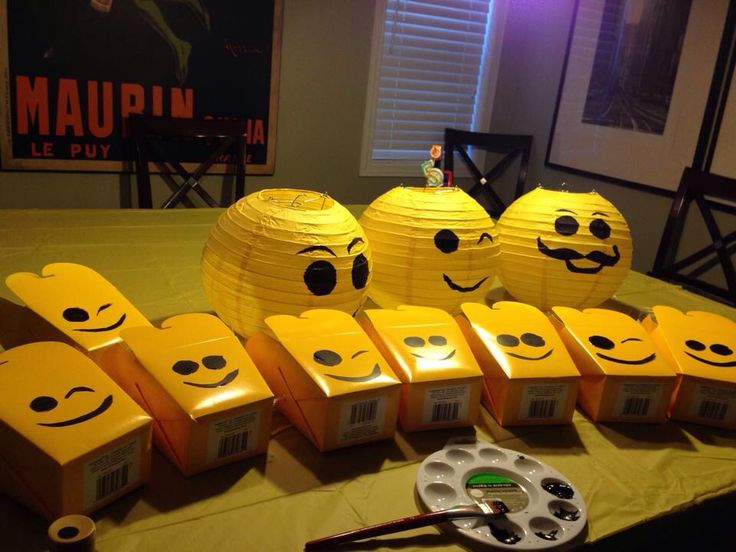 Lego party - lego lanterns and lego party favour boxes. Bought the plain yellow items and painted on the Lego faces