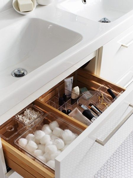 Clear plastic dividers keep drawers organized and make the most of the space inside the vanity. Separate containers for cotton balls, cosmetics and cleansers also mean things are found quickly, so time isn't lost searching through messy drawers.
