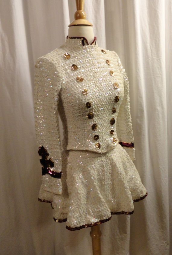 A wonderful white sequined Majorette Uniform purchased and worn in the mid to late 1970s. This baton twirlers costume was a one owner uniform