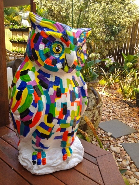 I painted this clay owl to match my kaleidoscope series, then sealed it with resin.  70cm high, it greets guests at our front door.