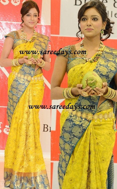 Latest Saree Designs: kalaniketan yellow kanchipuram bridal silk saree
