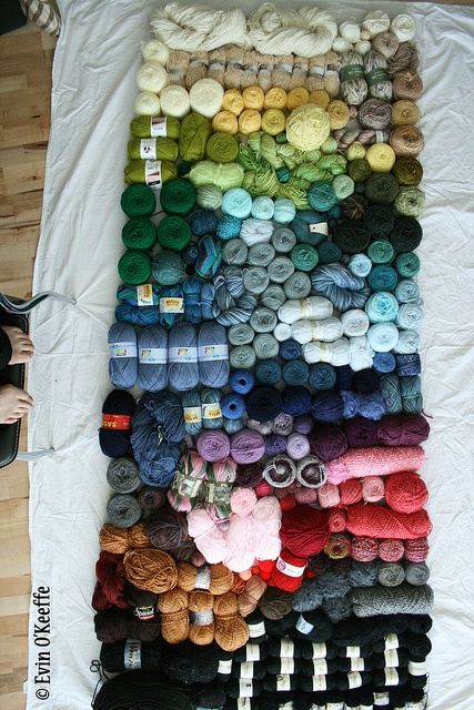 An aerial photo of 246 balls of yarn in a rainbow. Mmm, time to knit. Photo by Evin O'Keeffe.