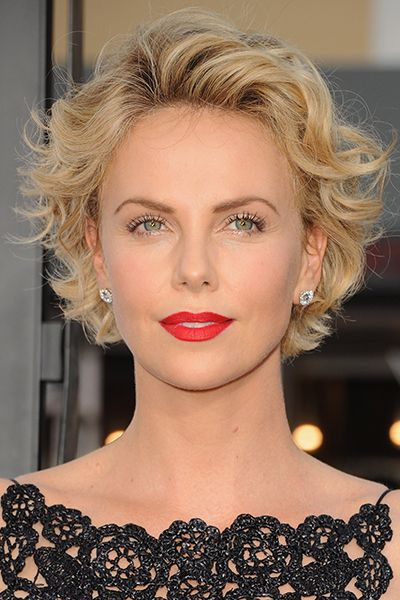 Charlize Theron - short blonde wavy hairstyle This style is perfect for naturally wavy and curly textures—when hair is damp, use a blowdryer to push the hair back off the face then run a curl enhancing cream through the front and back