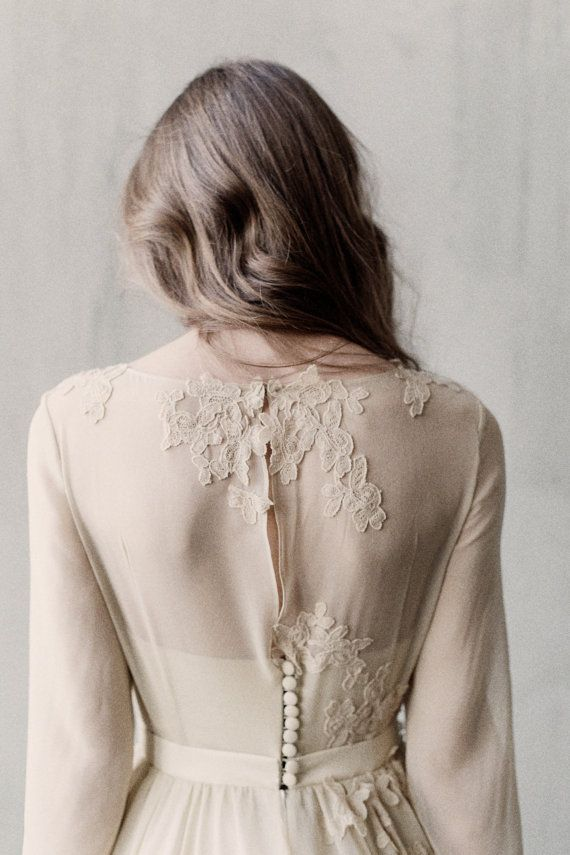 Olive long sleeves lace wedding dress with a corset / http://www.deerpearlflowers.com/unique-sophisticated-wedding-dresses-from-cathy-telle/