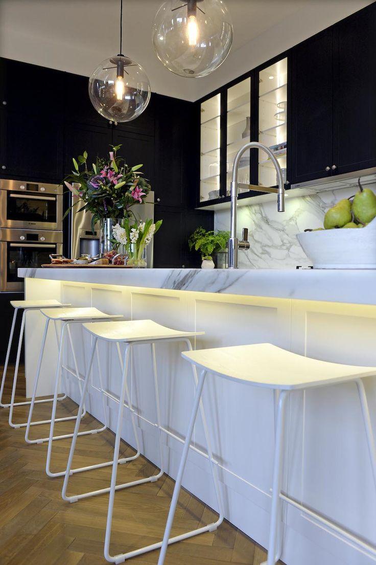 Glass pendant lights in kitchen, marble splashback, black cabinets and wood herringbone floor in kitchen #stylecurator #stylecuratorau #theblock