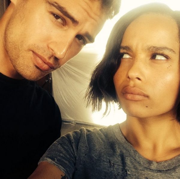 """Four (Theo James) and Christina (Zoe Kravitz) from the set of 'Insurgent'.  Zoe instagrammed this photo and the caption read """"On the set with this guy. Ugh."""""""