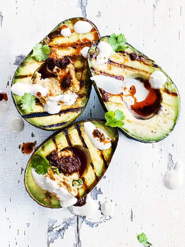 We love avocado! With this recipe for grilled avocado halves with harissa hummus and tahini yogurt, we've promoted it to BBQ star.