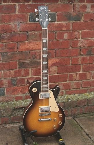 1982 Gibson Les Paul Tobacco Sunburst Guitar , and other bad ass guitars for his collection.