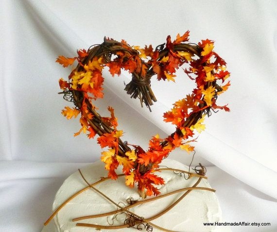 A unique heart shaped grapevine cake topper decked in vivid orange and yellow leaves that is perfect for your Fall wedding reception. FIND WITHOUT